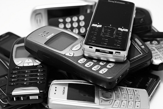 Pile of used cellphones