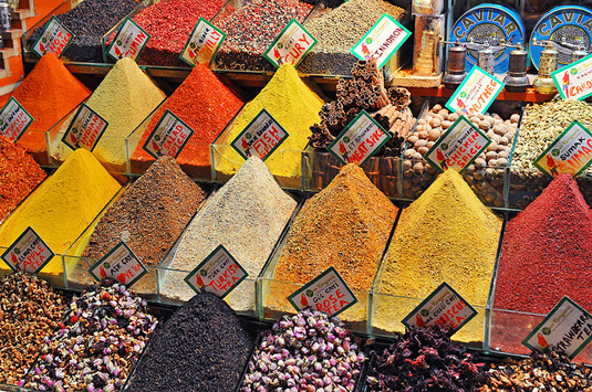 Small business storefront with pyramids of spices