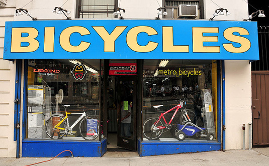 Improving the curb appeal of a small business, New York bicycle shop storefront